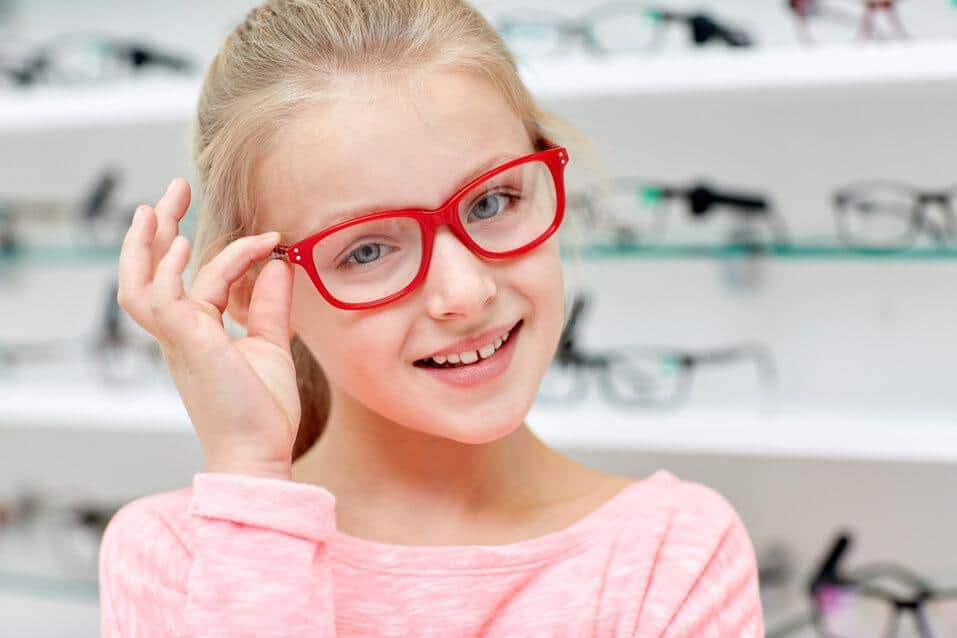lazy eye amblyopia pretty blonde girl child wearing red glasses